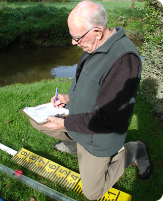Gordon Rudd has been recording water clarity at Cashmere Stm for 4 years; Photo RSmith.